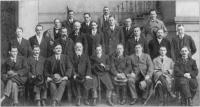 Members of the First Dail Eireann, 21January 1919. Seated from left'.J. O'Doherty, S. Hayes,J.J. O'Kelly, Count Plunkett, C. Brugha, S.T. O'Kelly, P.O'Malley, JJ. Walsh, T. O'Kelly, Standing from left: S. MacSwiney, K.O'Higgins, R. Barton, D. Buckley, R. Mulcahy, E. Duggan, C. Collins, P. Beazley, P. Shanahan, Dr. J. Ryan, Dr Crowley, P. Ward, i.A. Burke, P.J. Maloney, R. Sweetman.