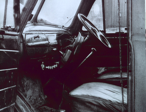 The bullet-riddled interior of the truck. (Des Long)