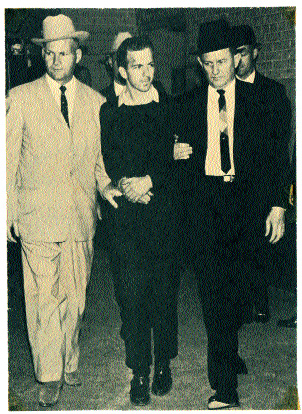 Oswald being escorted from a Dallas police station, seconds before he was gunned down by Jack Ruby. Some conspiracy theorists claim that they knew each other.