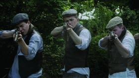 Dramatic reconstruction of the IRA firing squad at Coolacrease. The medical records do not support the programme's contention that there was sexual mutilation involved—i.e. that the Pearsons were deliberately shot in the genitals and the buttocks—but suggest rather that this was a botched execution carried out by inexperienced volunteers. (RTÉ Stills Library)