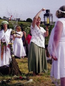 Sister Mary Minehan, a Brigidine nun, holds the perpetual flame brought from their house at Kildare in Ireland to Bride's Mound, Beckery, where a special garden was built to honour the goddess Brigid in 1994.