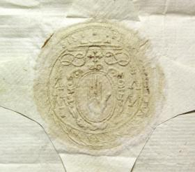 Ó Maolchonaire's crest: the Red Hand, surrounded by a flowing material known as mantling, appears below a flat, wide-brimmed episcopal hat, flanked by rows of tassels on each side. The archbishop's cross appears between the hat and the Red Hand, denoting his metropolitan jurisdiction as primate of Connacht. Although only the beginning and end of the inscription (top right and top left respectively) are visible in this particular reproduction, the edge of the seal is inscribed with Ó Maolchonaire's name and title in Latin: Florentius Conrius Archiepiscopus Tuamensis. (Archivo General de Simancas)