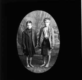 Two Dublin street urchins, autumn 1913. Although often recalled with nostalgia, the photographic record is striking for the sheer multitude of children and families living in overcrowded, dirty, squalid conditions. (Royal Society of Antiquaries of Ireland)