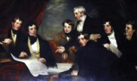 Family portrait of the Barrington family in 1830 (by Martin Cregan), preparing plans for the Limerick hospital that bore their name. The plaque over the door credits Joseph with its establishment, but his son Matthew was the driving force behind the project. Note how Joseph (standing) points to Matthew (second from the left), recognising his elder son's major role in the venture and acknowledging him as future head of the family. (Glenstal Abbey)