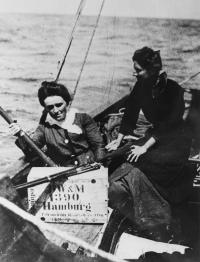 Mrs Childers and Mary Spring Rice aboard the Asgard with Mauser rifles and ammunition boxes (marked 'Hamburg') about to be landed in July 1914. Over the last three years the yacht has been undergoing conservation at the National Museum of Ireland, Collins Barracks, and will be going on permanent exhibition in 2011. (National Museum of Ireland)