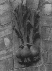 One of the building's many details in the form of fruit or vegetables - in this case a bunch of onions