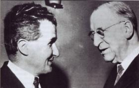 The late T. P. O'Neill, an expert on 'discovery', with President Eamon de Valera, whose signature features in the Registry.