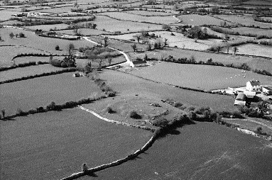 An enclosure crowning Tulach Mac Amhalghaidh (at centre of picture), the gathering place of the Magawleys of Calary, near Moate, County Westmeath.