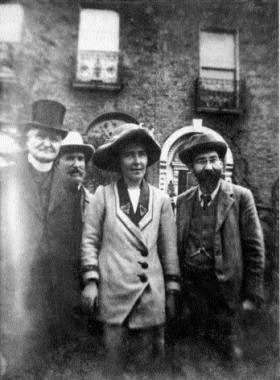 Hanna and Frank with (left) Fr Eugene Sheehy (Hanna's uncle) on the day of her release from Mountjoy, August 1912. (National Library of Ireland)