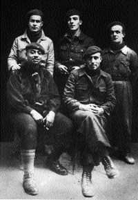 Soldiers of the International Brigade-[left to right, standing] Peter O'Connor (Waterford), P. McEvoy (Dublin), Johnnie Power (Waterford), [seated] W. Garland (USA), John Hunt (Waterford), 2 February 1937, four days before the Nationalist offensive at Jarama.