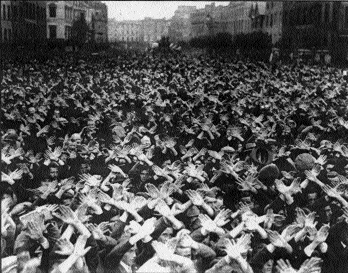 Irish Christian Front demonstrators in Cork make the sign of the cross above their heads. (Cork Examiner, 21 September 1936)