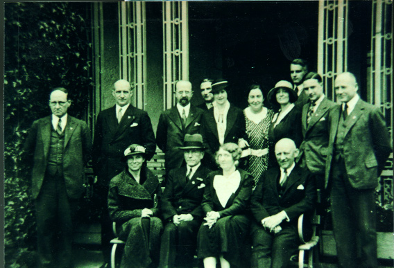 Sixtieth birthday party of Col. Fritz Brase (seated, wearing hat) at his Sandymount home, 4 May 1935. Other Nazi Party members include (standing, left to right) Adolf Mahr, Otto Bene (head of the Nazi Party in London) and Oswald Mueller-Dubrow (a director of Siemans engineering company).