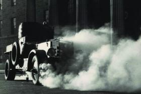 An armoured car comes under attack outside the GPO.