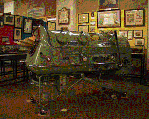 'Iron lung' c. 1950s-one survivor described the experience as similar to lying in a coffin with one's head sticking out.