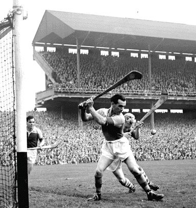 Action from the 1956 All-Ireland hurling final. Cork got to (and were beaten in) both hurling and football finals. Both matches were postponed at the request of Dublin health authorities worried by the prospect of large numbers of Cork people descending on Croke Park. (Cork Examiner)