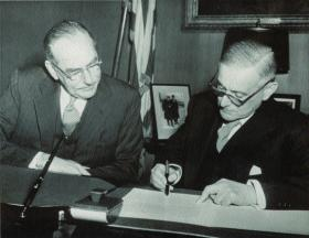 Hearne later became ambassador to Washington. He is seen here (right) signing the Double Taxation Agreement in December 1951 under the watchful eye of US Secretary of State Dean Acheson. (Irish News Agency)