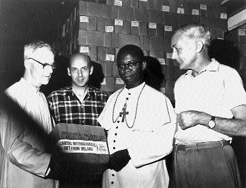 Limerick-born Bishop Joseph Whelan of Owerri (left) accepts Caritas aid flown in from Sao Tomé. The Nigerian federal government claimed that aid flights were a cover for gun running. (Independent Newspapers)