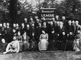 The Hammersmith branch of the Socialist League (founded by Morris in December 1884)-Morris is fourth from the right, middle row. (Victoria and Albert Museum, London)