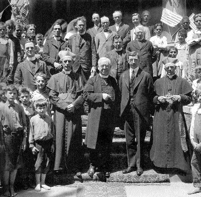 Fr Flanagan (extreme left) in a group photograph with de Valera when he visited Boys' Town in the course of his 1920 American tour. Note the black boy (top right-hand corner). Boys' Town's racial mix demonstrated the radical nature of Flanagan's project. (Hall of History, Boys' Town)