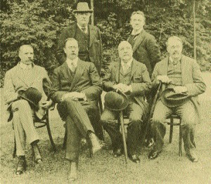 Stanford (far right) with Hubert Parry, Alexander Mackenzie, Edward German, Edward Elgar and Dan Godfrey at Bournemouth, 1910.