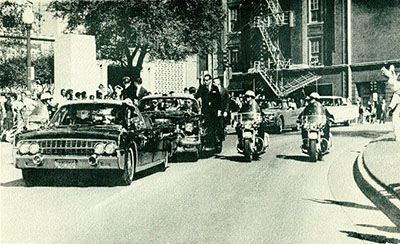 Seconds before the fatal shooting-the presidential cavalcade enters Dealey Plaza. (James Altgens)