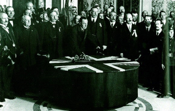 Sir Edward Carson signing the Solemn League and Covenant in Belfast City Hall, 28 September 1912; this declared that 'Home Rule would be disastrous to the material well-being of Ulster as well as to the whole of Ireland'. While hinting at a partitionist mindset, Carson was pursuing a logic that if 'Ulster' succeeded, Home Rule would be dead. But what or where was 'Ulster'? (George Morrison)