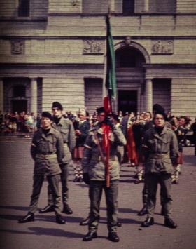 IRA colour party outside Christ the King Cathedral, Mullingar, in July 1969 for the reinterment of Peter Barnes and James McCormack, two IRA men executed in 1940 for their role in the bombing of Coventry the previous year. An estimated 10,000 attended, and the Department of Justice was critical of the fact that 'the parade in commando style uniform and the firing of shots at the graveside' took place unhindered and that it was described as an IRA operation in press and TV coverage. (Seamus Murphy)