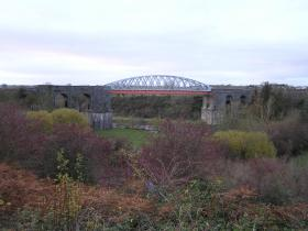 The iron bridge that replaced it in 1877 as it is today.