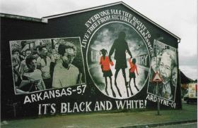 Mural denouncing the 2001 loyalist blockade of Holy Cross girls' primary school, Ardoyne. Early in 1966 the UVF firebombed the same school. Captain O'Neill was due to address a conference there on how to promote better relations between Protestants and Catholics. (Irlanda Notizie)