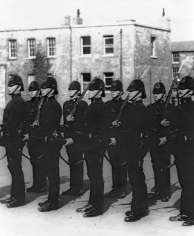 RIC constables drilling with fixed bayonets c. 1920. By late spring 1920 the RIC became an even more militarised body, with heavier weapons and equipment. (Garda Archives)