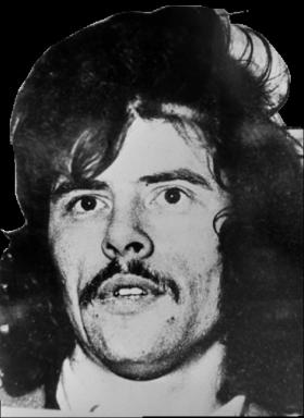 Gerry Adams at the time of his arrest in 1974; he has contended that the IRA's actions were 'decisive' in repelling loyalist attacks. (Victor Patterson)