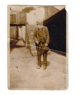 The author's great-grandfather, Francis Melanaphy (c. 1923), at steps to the old granary/loft at the rear of Drumm's, Ballyconnell, where parish arbitration courts were held. Plaintiffs were seen fist-fighting going in and shaking hands coming out.