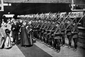 The papal legate, accompanied by de Valera, blesses the military guard of honour. Excommunicated from the church during the Civil War, the congress provided de Valera with the opportunity to demonstrate his Catholic bona fides. (Multitext Project)
