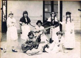 A carnival party at Youngs ranch c. 1930s. Sara and Louise Young (with guitars) and their friends wear fancy dress representing Argentinian native women. (Centro Argentino Irlandés de San Pedro)