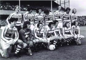The Shamrock Rovers All-Ireland XI—(back, left to right) Miah Dennehy (RoI & Nottingham Forest), Tommy Craig (NI & Newcastle United), Paddy Mulligan (RoI & Crystal Palace), Martin O'Neill (NI & Nottingham Forest), Derek Dougan (NI & Wolverhampton Wanderers), Alan Hunter (NI & Ipswich Town) and Liam O'Kane (NI & Nottingham Forest); (front, left to right) Bryan Hamilton (NI & Ipswich Town), Pat Jennings (NI & Tottenham Hotspurs), Tommy Carroll (NI & Birmingham City), John Giles (RoI & Leeds United), Don Givens (RoI & Queen's Park Rangers), Terry Conroy (RoI & Stoke City) and Mick Martin (RoI & Manchester United). (SPORTSFILE)