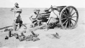 A Royal Field Artillery 18-pounder field gun, of the type used by Tom Barry's unit, in action in Mesopotamia (Iraq) in March 1917. (Imperial War Museum)