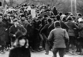 Burntollet bridge, January 1969—loyalist ambushers coming from the Ardmore road openly attack the front rank of the People's Democracy march unimpeded by the RUC presence. (Belfast Telegraph)