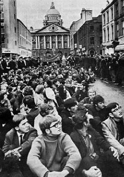 Some of the c. 2,000 Queen's University students sitting down outside Belfast City Hall on 5 October 1968 in protest against 'police brutality' in Derry. Following the events of that day, People's Democracy, the organiser of the January 1969 march, was formed.