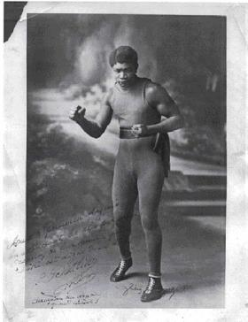 Light heavyweight champion Louis M'Barick Fall from Senegal, a.k.a. 'Battling Siki'. He later succumbed to alcoholism before being murdered in New York in 1925.