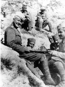 Sergeant-Major Flora Sandes playing chess with Serbian comrades during a lull in the fighting. (Sandes family)