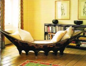 Gray's first interior was for Mrs Mathieu Lévy, a wealthy boutique-owner and milliner, and included this Pirogue day bed. A 1920 issue of Harper's Bazaar described the apartment as 'thoroughly modern although there is much feeling for the antique'.