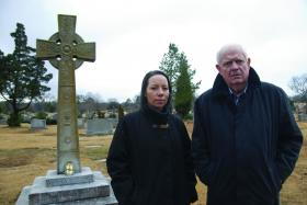 Presenter Brendan Shine with the author of Rising Road, Sharon Davies, at the grave of his grand-uncle, Fr James Coyle , in Birmingham, Alabama. (RTÉ)