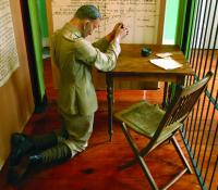 A life-size representation of James Daly praying in his cell the night before his execution at King's House Museum, Boyle. The display stresses the concern of the mutineers for their friends and family at home rather than for an abstract republican ideal. (King House Museum, Boyle)