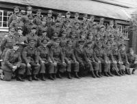 The 33rd Infantry Battalion platoon of Sergeant Hugh 'Sonny' Gaynor from Leixlip, Co. Kildare (front row, sixth from right), seated beside Lieutenant Kevin Gleeson (wearing gloves). (Military Archives)