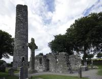Monasterboice today and as depicted on the harp, not as ruins but with roofs. (Kevin King).