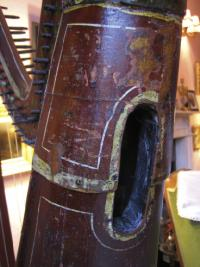 One of the three sound-holes in the rounded back soundbox. Note the addition of a thin iron band to prevent twisting: '[we have] by our improvement on the construction of the national instrument, given to it imperishable strength'—Fr Burke.