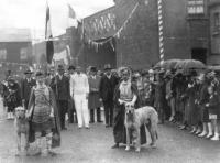 The parade from the 1928 Tailteann games at Croke Park. NACA president J.J. Keane is in the centre of the picture (to the left of the right-hand wolfhound-handler). When in 1924 he agreed to drop the NACA's rule (inherited from the GAA) excluding British servicemen and police from membership and accepted a compromise on Sunday competitions, the Northern clubs accepted unity—but not for long. (Cyril White)