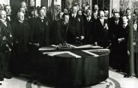 Sir Edward Carson (with James Craig to his left) signing the Solemn League and Covenant in Belfast City Hall on 'Ulster Day', 28 September 1912, the culmination of a range of stunningly impressive events masterminded by Craig. (George Morrison)