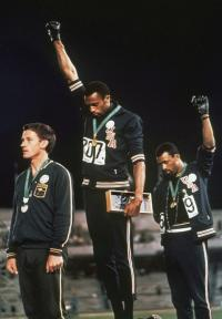 US athletes Tommie Smith (200m gold) and John Carlos (bronze) raise their fists in a Black Power salute at the 1968 Mexico games, for many Irish people the first televised games they saw.
