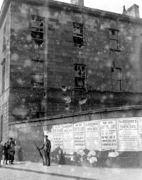 A soldier guards British Army recruiting posters on a wall of the battered Four Courts in the wake of the Rising. (TopFoto)